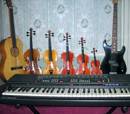 image of several instruments - guitars, violins, keyboards