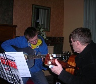 image of students learning to play guitar
