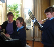 image of students learning to play their instruments